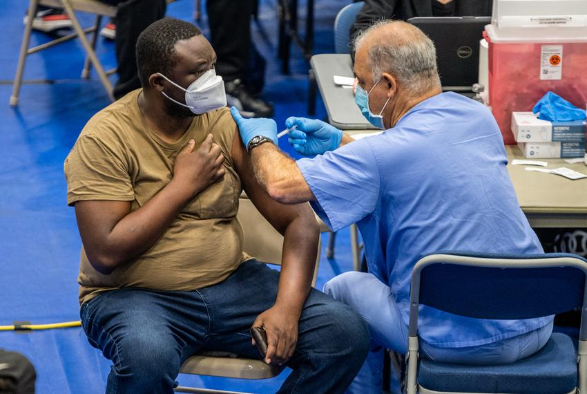 A patient receives their vaccination against COVID-19 at the Delco Activity Center in Northeast Austin, on March 13, 2021.