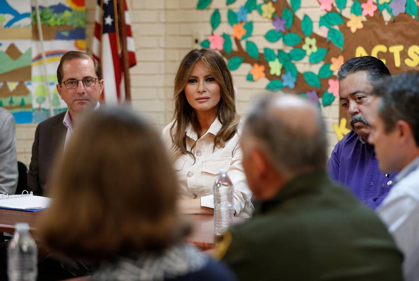 First lady Melania Trump and U.S. Secretary of Health and Human Services Alex Azar (left) listen during a roundtable meeti...
