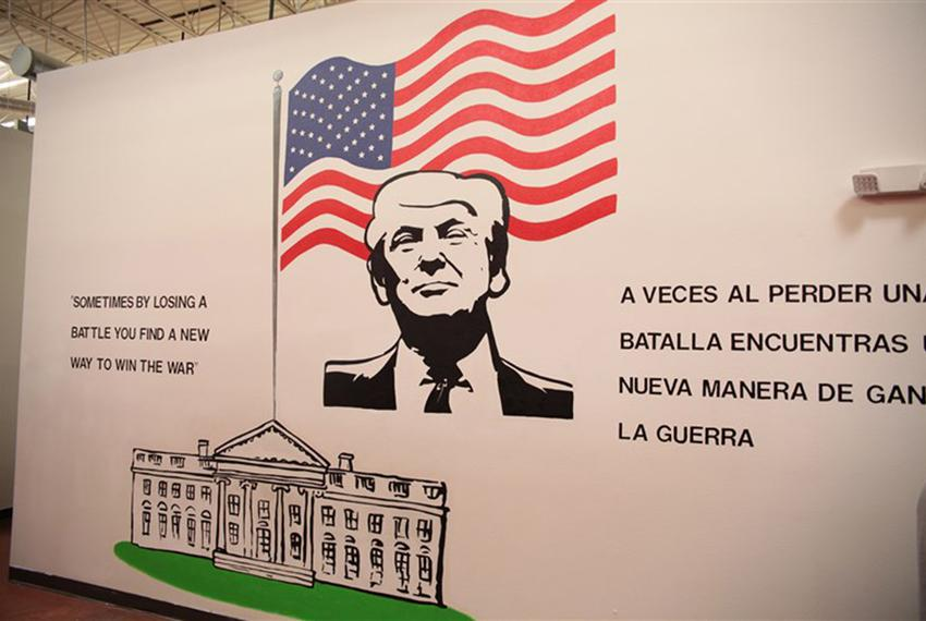 A mural of President Donald Trump in the Casa Padre immigrant shelter in Brownsville. The center is located in a store that …
