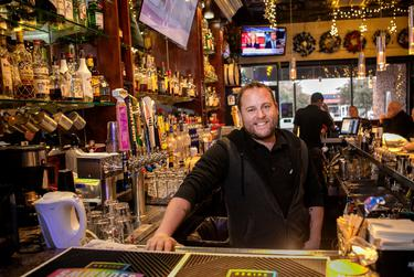 Lee Daugherty, owner of Alexandre's Bar in Dallas, posed for a portrait behind the bar Dec. 12, 2018. He pays the staff at Alexandre's $8 an hour with a $15 per hour guarantee, up from the federally mandated $7.25 an hour.