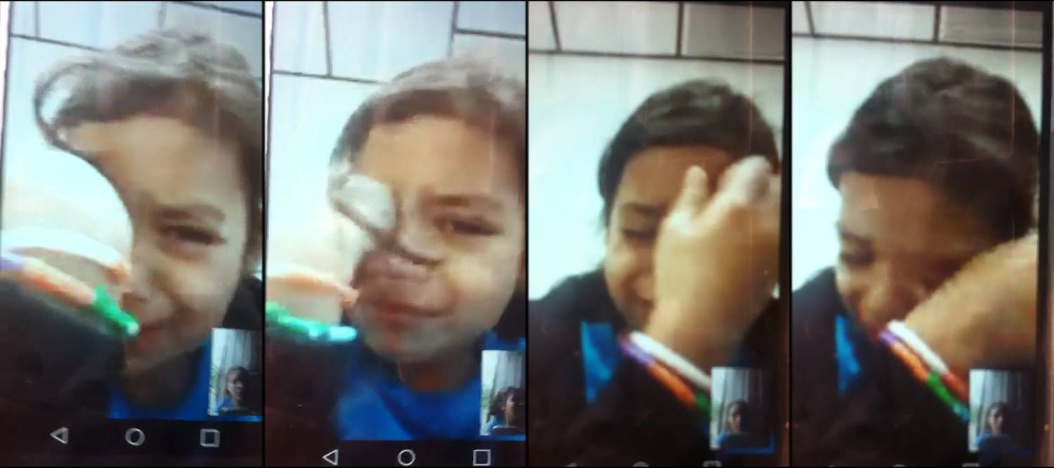 6-year-old Heyli in a video call with her mother, Claudia, on July 20.