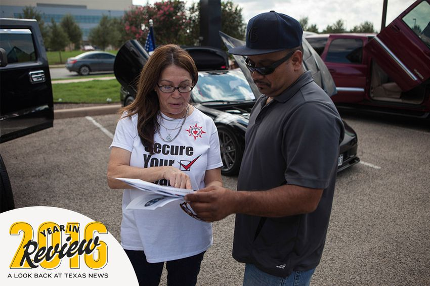Jill Ramirez, the director of outreach for the Latino Healthcare Forum, passes out flyers and explains components of the Affordable Care Act on Oct. 5, 2013. With Donald Trump's election to the White House, the health law faces an uncertain future.
