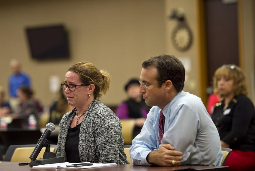 Jean Gearhart gives a tearful statement with her husband Troy Gearhart to the panel about her special needs child. U.S. Depa…