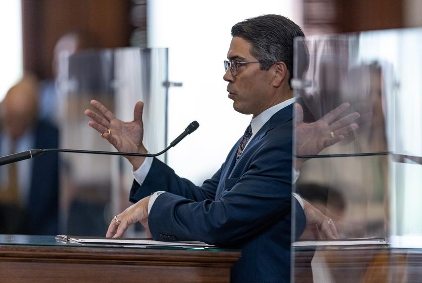 State Rep. Chris Paddie, R-Marshall, speaks from the podium at the front of the House of Representatives on Sunday, May 23, …