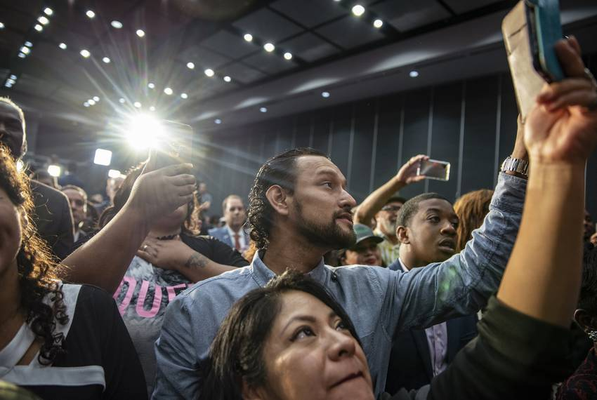 Supporters listen to Houston mayor Sylvester Turner address a crowd of supporters during an election night party at the Ge...