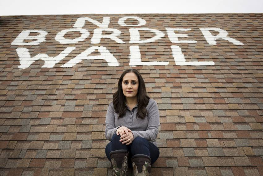 """Naida Alvarez painted """"No Border Wall"""" on the roof of her home in La Rosita. Alvarez has received letters from the U.S. Go..."""