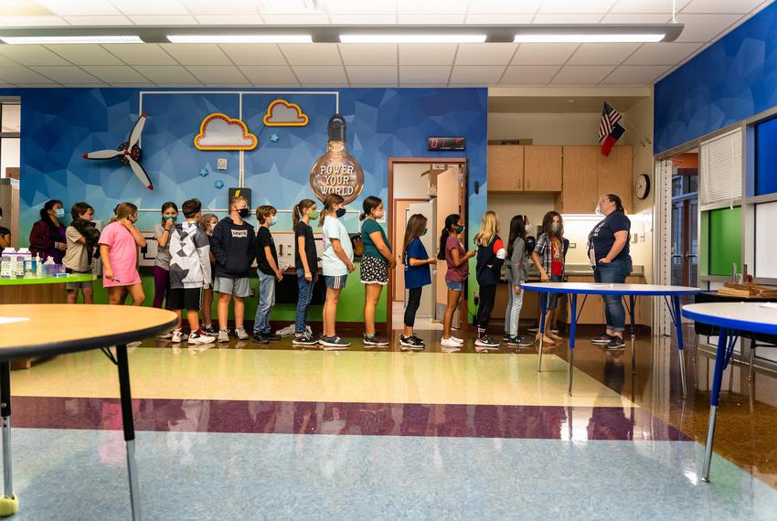 Fifth graders at Jacob's Well Elementary School in Wimberley lineup at the door as they prepare to walk back to their classr…
