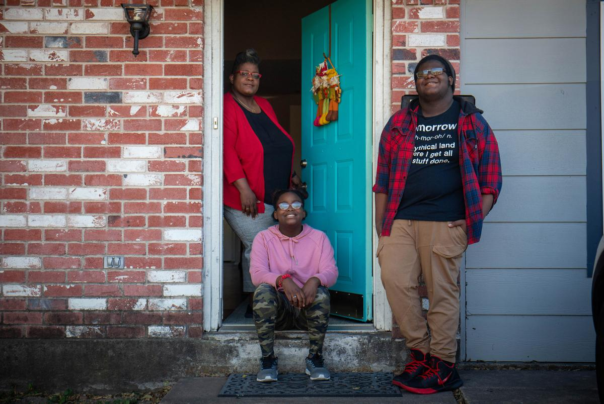 Candace Hunter's children are home-schooled due to the pandemic and have been struggling to manage the onslaught of assignments that come with remote learning. Hunter and her children are photographed here in Austin on Nov. 17, 2020.