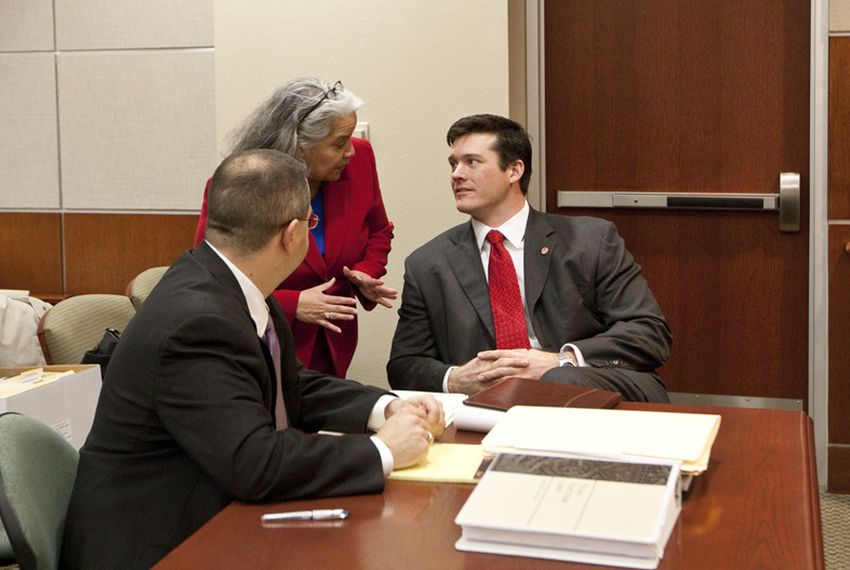 Dan Neil at table with attorneys during a public hearing for the election contest of House D-48