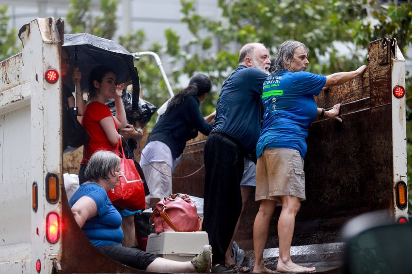 Evacuees from Meyerland — a neighborhood in southwest Houston hit hard by Harvey —arrive at theGeorge R. Brown Convention Center on Sunday, Aug. 27, 2017.