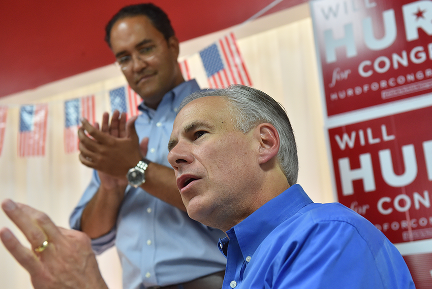 Texas Governor Greg Abbott speaks to supporters of Congressman Will Hurd (background) during a Saturday afternoon appearan...