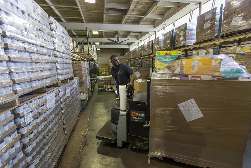 Damon Smith helps unload a truckload of food and supplies at the Southeast Texas Food Bank in Beaumont on Wednesday, Sept. 2…