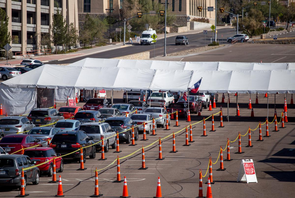 Residents wait in line at a COVID-19 testing site at the University of Texas at El Paso on Nov. 19, 2020.