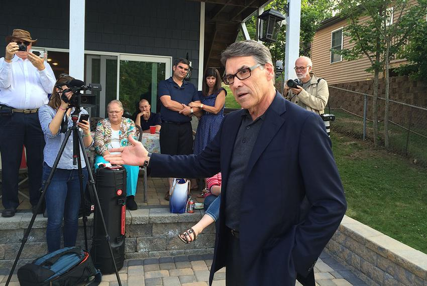 Rick Perry delivers his stump speech to Republican voters and activists at a lake house near Derry, New Hampshire on July 3,…