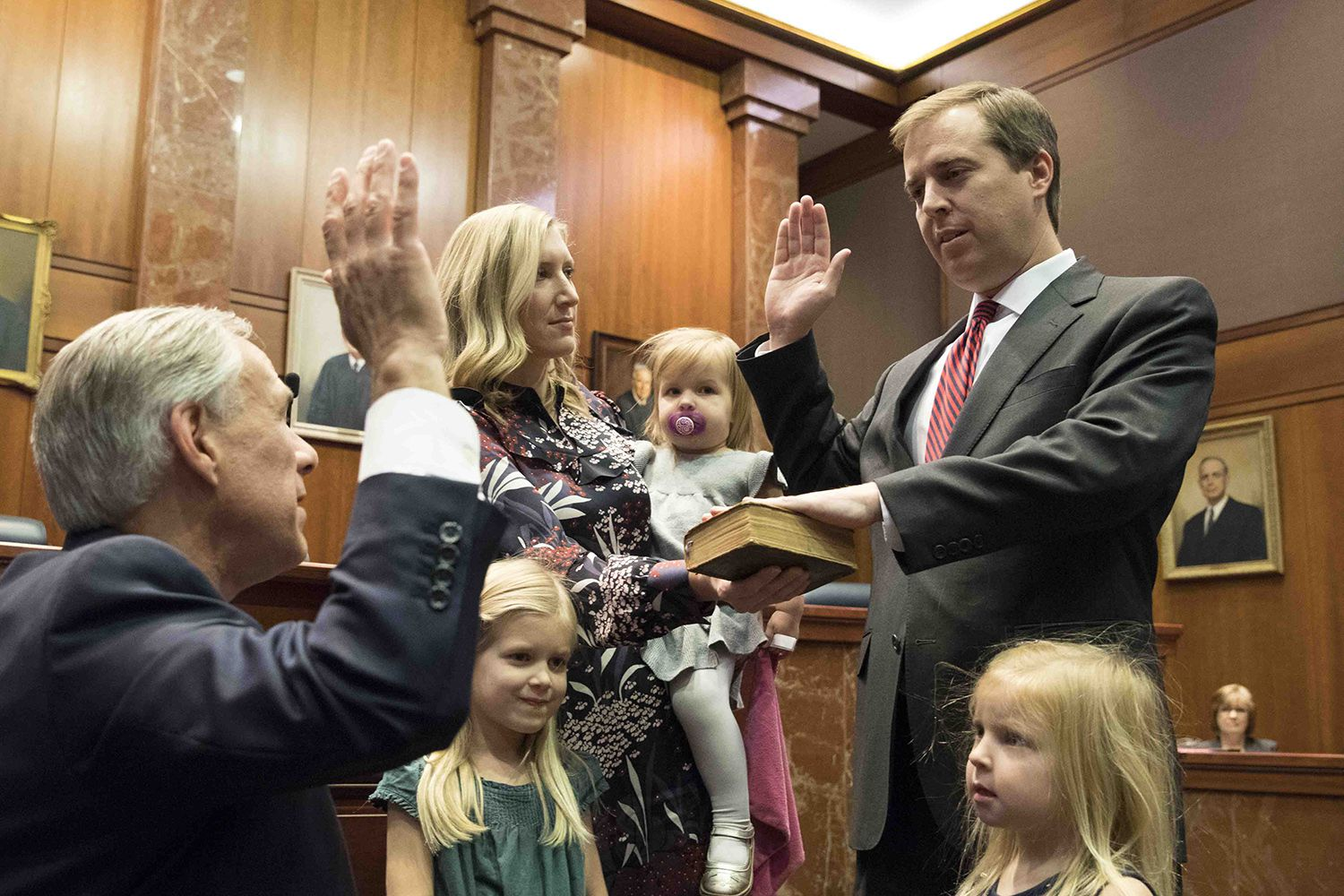 Gov. Greg Abbott swears in Jimmy Blacklock to replace Don Willett on the Texas Supreme Court on Tuesday, Jan. 2, 2017. Blacklock previously served as the governor's general counsel.