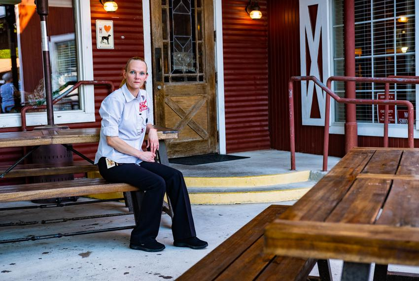 Donna Heath, floor manager of The Barn Door Restaurant, poses for a portrait during her shift in front of the restaurant in …