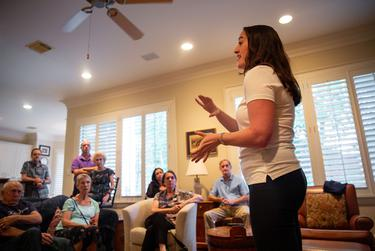 Allison Lami Sawyer speaks to a crowd about her platform ideas at a meet and greet in West University Place on Oct. 6, 2018.