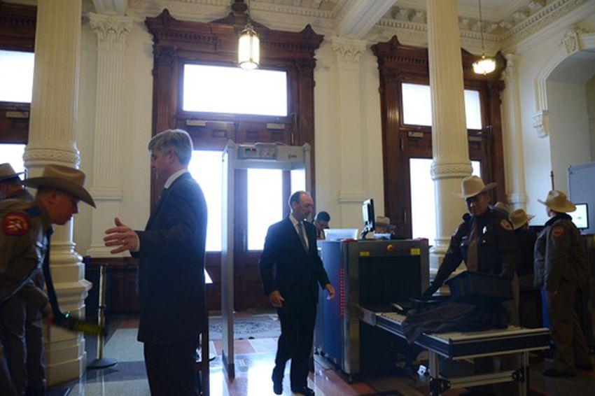 Capitol visitors pass through metal detectors.