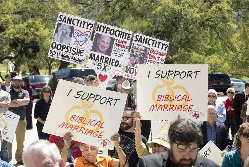 During the Defense of Texas Marriage Amendment Rally on Mar. 23, 2015 at the Texas Capitol, a protester raises questions o...