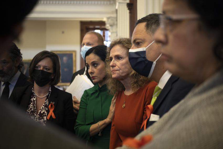 State Rep. Donna Howard, D-Austin, is surrounded by fellow Democrats after testifying against a proposed anti-abortion bill …