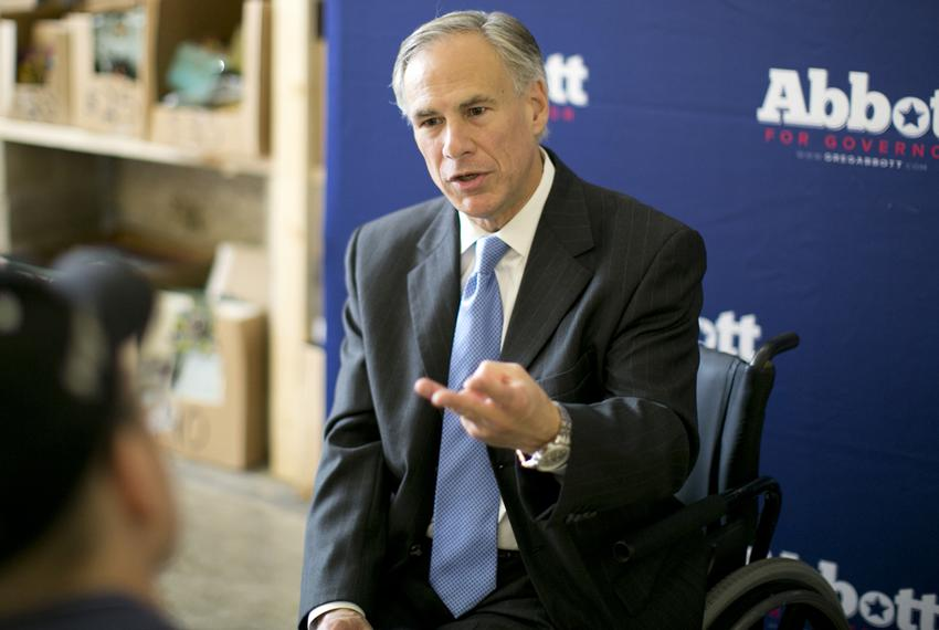 Republican attorney general and gubernatorial candidate Greg Abbott speaks one-on-one with members of the media following ...