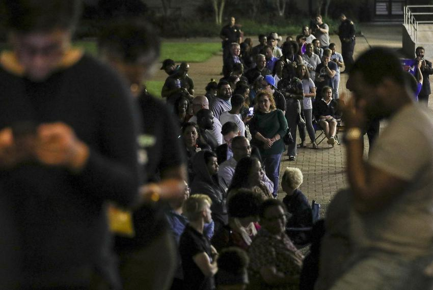 People wait in line to vote around 9:45 p.m. Tuesday, March 3, 2020, at Texas Southern University in Houston.