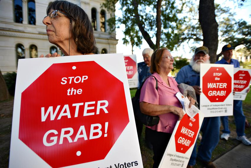 Bastrop County resident Charlotte Gilman protests the Vista Ridge Water Supply Project with other Lee and Bastrop County res…