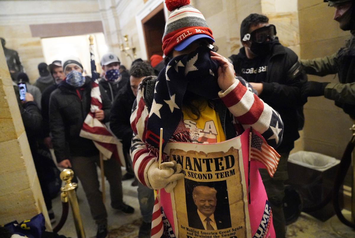 Trump supporters enter the Capitol building during a joint session of Congress in Washington, DC on Jan. 6, 2021. The joint session of the House and Senate was sent to recess after the breach as it convened to confirm the Electoral College votes cast in November's election.