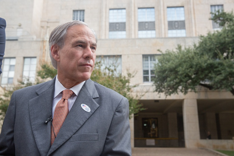 Gov. Greg Abbott speaks with reporters after voting early in the constitutional amendment election Wednesday at the Travis County Courthouse.