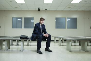 Lawyer Drew Willey sits in the holding cell for defendants on Galveston County's jail docket.