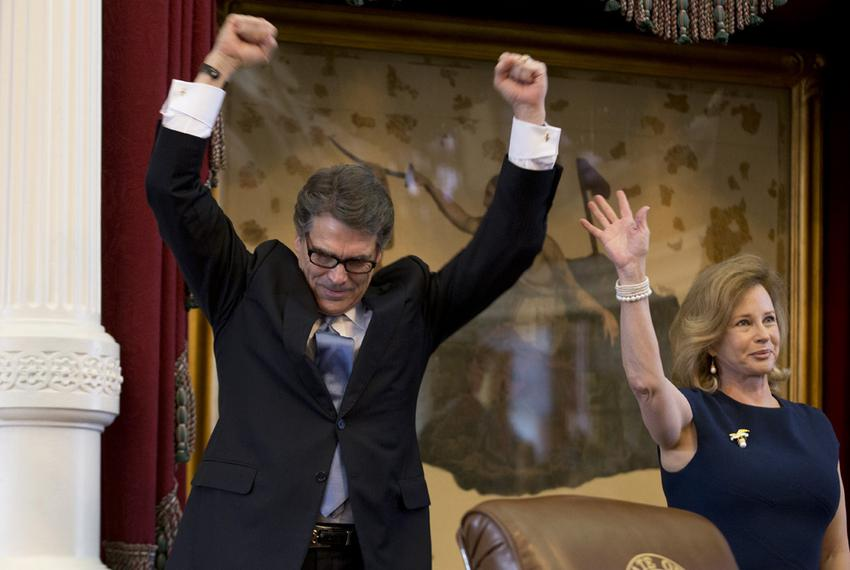 Governor Rick Perry and First Lady Anita Perry acknowledge cheers in the House chamber on their final appearance to the Texa…