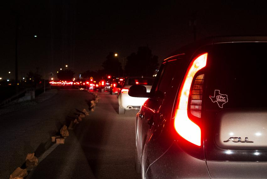 Cars line up at The Luminaria Remembrance Drive-thru vigil at Ascarate Park in El Paso. Aug. 2, 2020.
