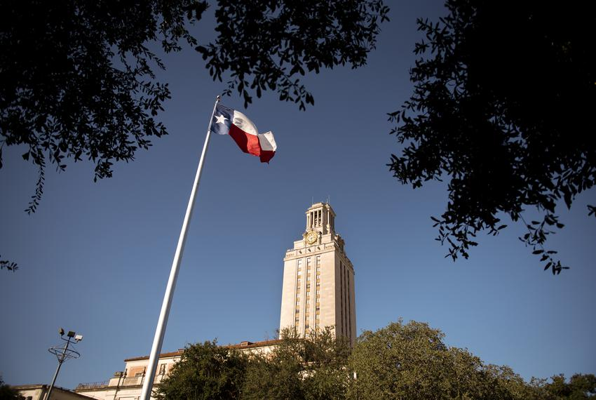 The Texas flag flies on the south lawn of The Univerisity of Texas at Austin campus on Dec. 3, 2019.