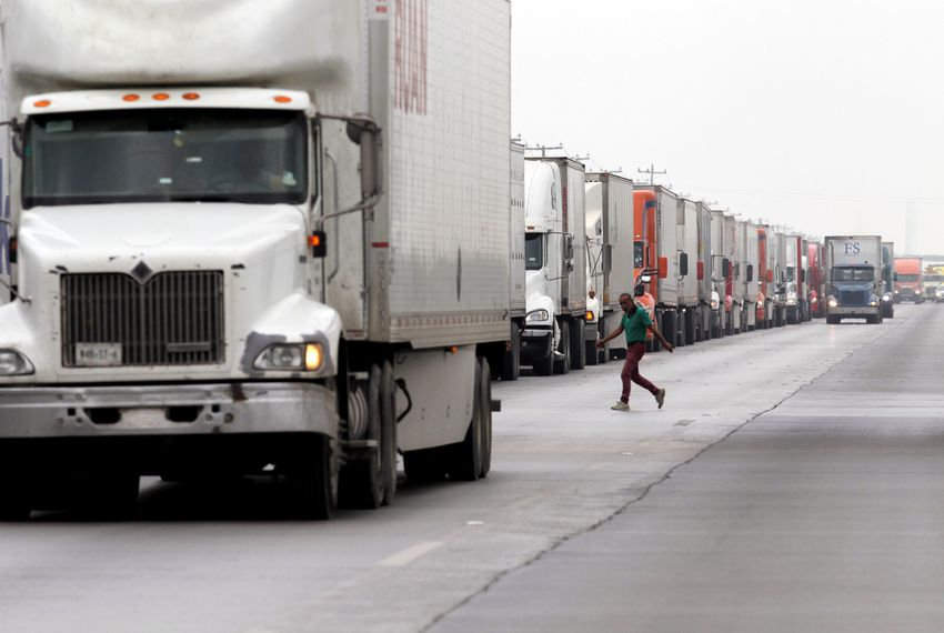 Trucks wait in a line to cross into the U.S. from Nuevo Laredo, Mexico.