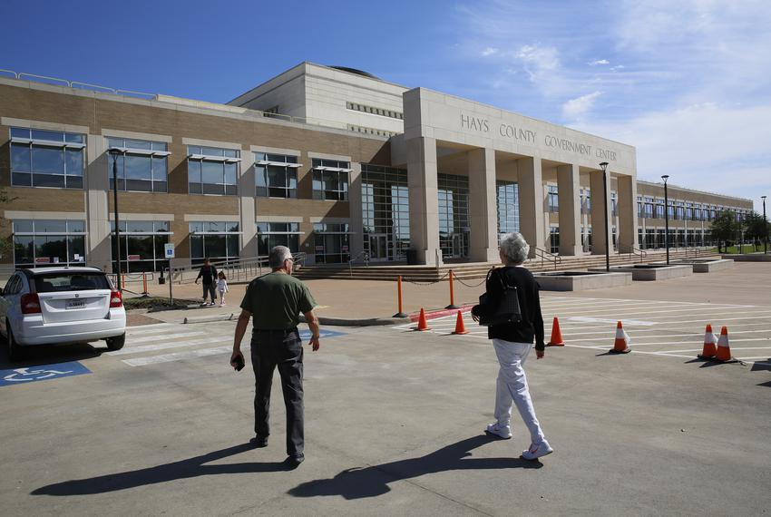 Voters head to the polls at the Hays County Government Center on Friday, Oct. 26, 2018.