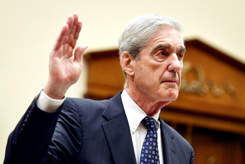 Former Special Counsel Robert Mueller is sworn in before testifying for the House Intelligence Committee in Washington, D....