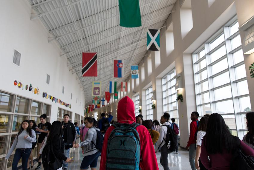 High school students walk to their next class after the bell rings at Elsik Ninth Grade Center in Houston on March 28, 2018.