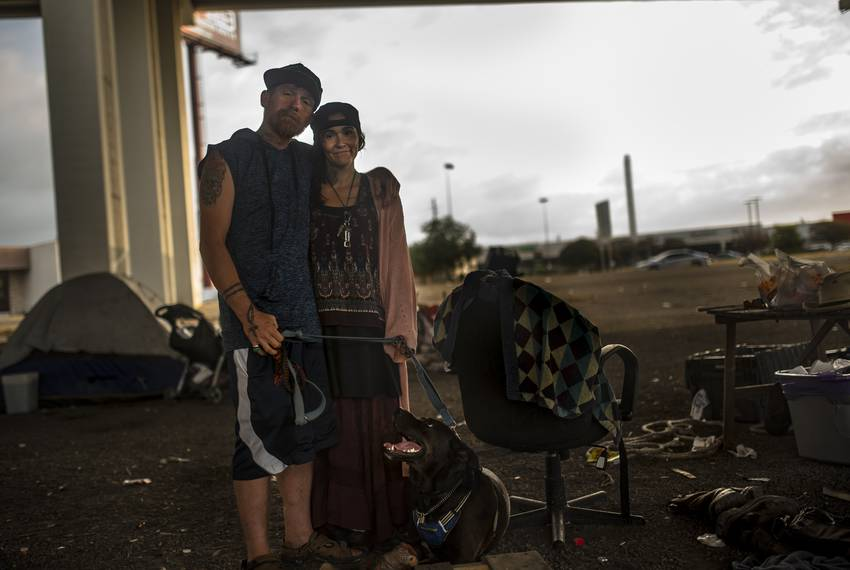 Forty year-old Harold Hicks, left, visits Austin residents experiencing homelessness with his wife, Gypsy. He owned a home...