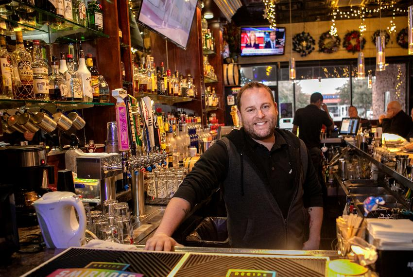 Lee Daugherty, owner of Alexandre's Bar in Dallas, posed for a portrait behind the bar Dec. 12, 2018. He pays the staff at A…
