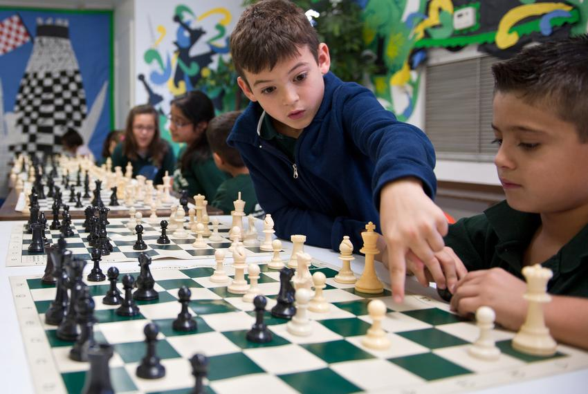 Brownsville's Sharp Elementary Chess Team members (L-R), Eduardo Rodriguez, 8 and Adrian Castro, 7 practice after school on …