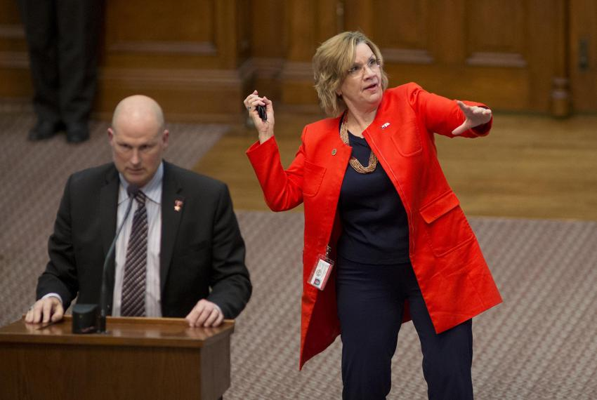 10:52 p.m. — State Rep. Molly White, R-Belton, pretends to throw an object to someone in the gallery.