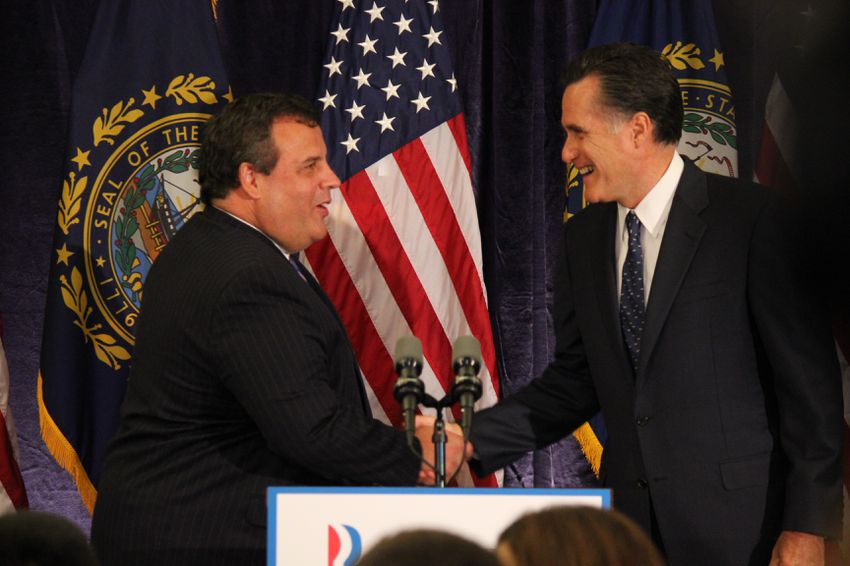 Mitt Romney and Gov. Chris Christie shake hands after Romney introduces him at event in Lebanon, N.H.