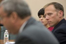 Texas Railroad Commissioners Christi Craddick, center, and Ryan Sitton, right, during a Sunset Advisory Committee hearing on Aug. 22, 2016.