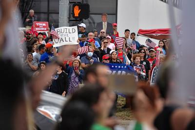 Protestors line the street near the McAllen International Airport before President Donald  Trump's arrival in McAllen on Thursday, Jan. 10, 2019.