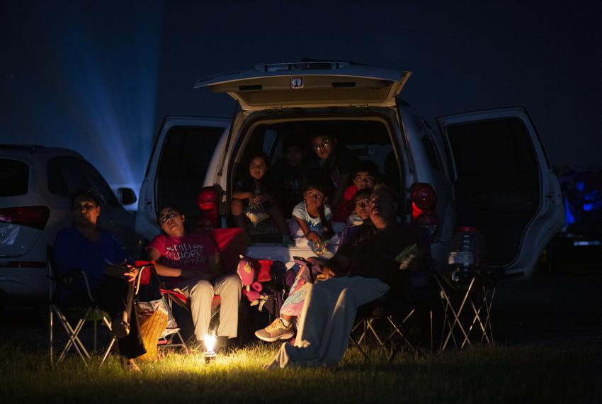 At left, Marta Linares and her family watch a movie at the WesMer Drive-In Theatre in Mercedes. They have been coming to the…