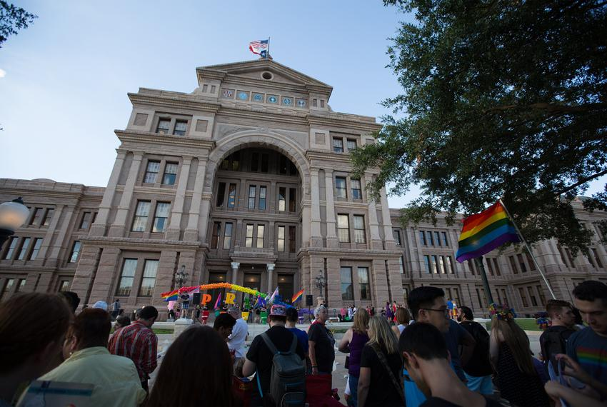 Activists and members of Austin's LGBTQ community gather on the steps of the capitol on June 28, 2017, to celebrate the anni…