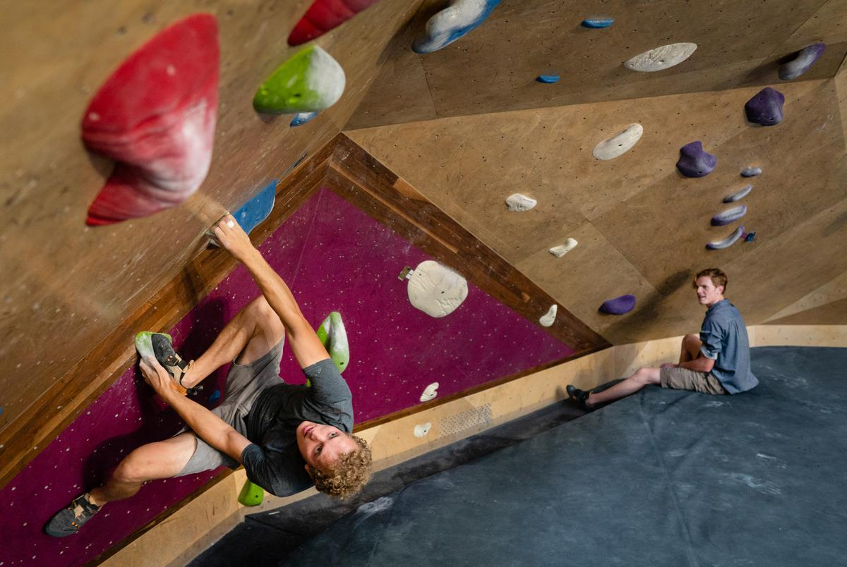 From left: Justin McGrath, 21, and Jonah Brenner, 22, boulder at Crux Climbing Center in South Austin on June 14, 2021.