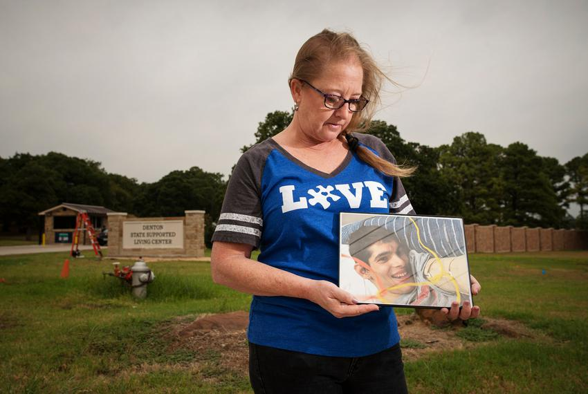 Stephanie Kirby holds a photo of her son, Petre Kirby, outside of the Denton State Supported Living Center, where her son ...