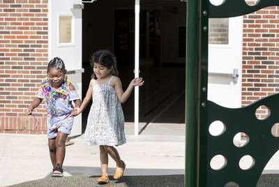 At Steele Montessori Academy, a formerly closed campus, Azeri'aha and Penelope Acuña hold hands and play during recess on April 26, 2018. Bexar County's school districts are among the most segregated in the state, with boundary lines historically drawn to consolidate resources. San Antonio ISD is working to create more socioeconomic and racial diversity through public school choice measures.