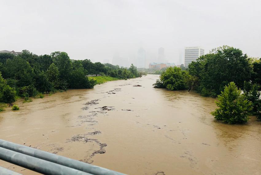 Heavy rain raises the level of the Buffalo Bayou in Houston on July 4, 2018.